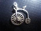 VINTAGE SILVER BRACELET CHARM NUVO PENNY FARTHING BIKE WHEEL MOVES