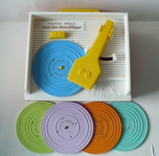 FISHER PRICE RETRO MUSIC BOX RECORD PLAYER WITH 5 RECORDS 2010