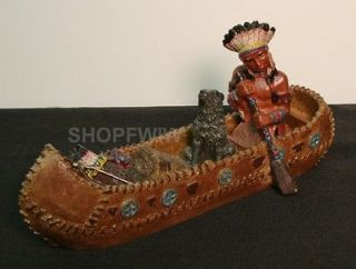 Native American Indian and Wolf in Canoe Figurine