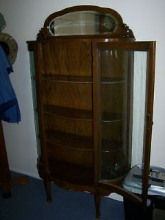 Antique Oak bow front china cabinet / curio With mirror