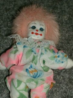 collectable porcelain clown doll with pink rabbit hair/fur