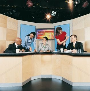 TV News Presenters, Make up Artist and a Producer in a TV Studio Stock