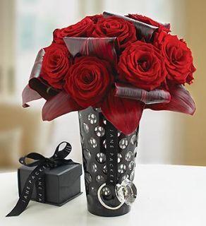 one dozen red roses in amethyst glass vase
