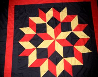handmade amish styled broken star with a bold graphic look quilt top