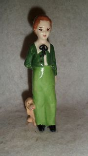 Vintage Holland Mold .Boy With Dog and Flowers Behind back Figurine