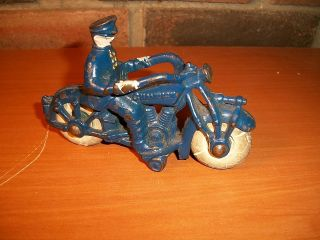 pre war champion cast iron motorcycle cop toy time left
