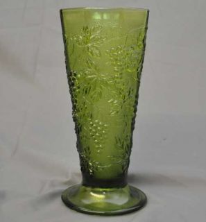 vintage green glass vase footed with a grape leaf looks like the