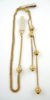 you are bidding on a designer gold tone rhinestone ball belt necklace