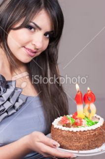 Girl holding Birthday Cake with Candles 18th Royalty Free Stock Photo