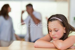 Sad girl with her fighting parents Royalty Free Stock Photo