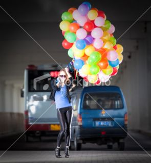 photo description young woman posing with 150 helium colorful balloons