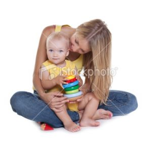 Smiling little girl with mother on white background  Stock Photo