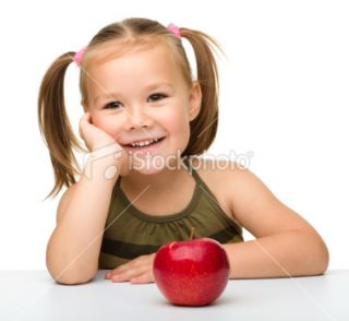 Little girl with red apple  Stock Photo  iStock
