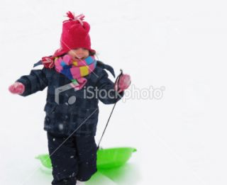stock photo 18662083 little girl playing in the snow