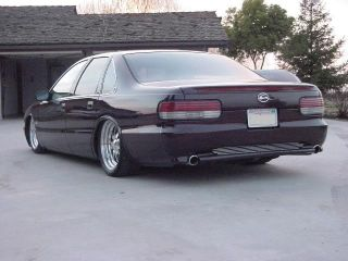 CUSTOM SMOOTH BUMPERS front FOG and rear ROLL PAN DUAL EXHAUST STYLE