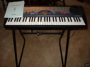 CASIO electronic keyboard & stand (61 piano style keys)