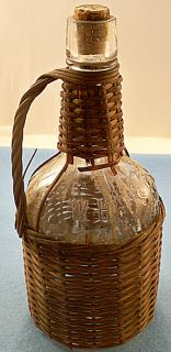 1893 embossed Old Times Whisky, Wicker Wrapped Glass Bottle