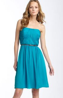 slender belt cinches a strapless silk chiffon dress with beautifully