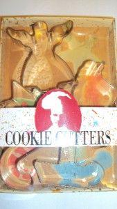 LOT 5~METAL CHRISTMAS COOKIE CUTTERS~SANTA, CANDLE, XMAS TREE, ANGEL