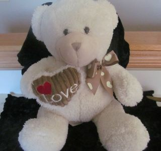 dan dee collectors bear off white in color with brown heart on chest