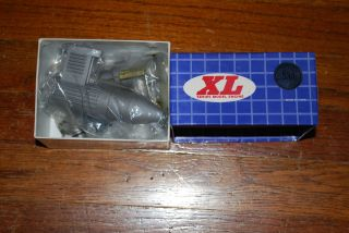 older Magnum XL 53 two stroke engine complete w muffler new in box
