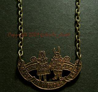 vintage alice in wonderland antiqued brass charm necklace