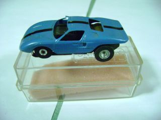 Aurora/Model Motoring Blue/Blk. Ford GT T jet slot car with case from