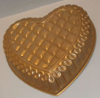 Get ready for VALENTINES DAYCopper colored metal heart shaped cake