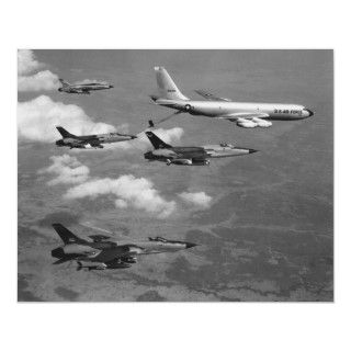Four F 105 thundercheifs being refueled by a KC 135 Stratotabker