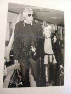 1980 James Coburn with Lynsey de Paul Press Photograph