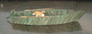 Camo Painted Duck Boat with Dog