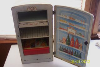 Vintage1950s 1960s Marx Tin Litho refrigerator shows Coca Cola Bottles