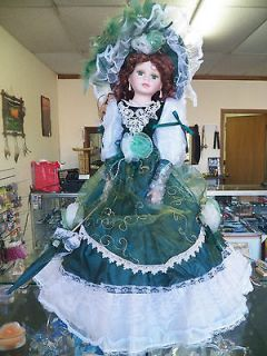 Green Dress Dark hair doll with umbrella Cathay Collection