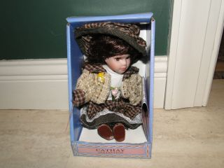 Cathay Collection Porcelain Doll Daina in Hat and Jacket, Only 5000