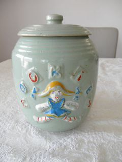VINTAGE LIGHT GREEN COOKIE JAR GIRL WITH PIG TAILS !!!!