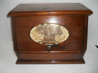 and attractive large wooden bread box with inlaid decorative plaque