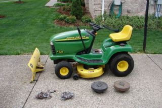 LT166 RIDING LAWN MOWER W/PLOW, REAR WHEELS WEIGHTS, AND TIRE CHAINS
