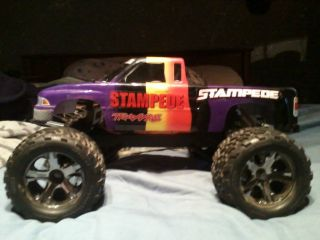 STAMPEDE radio controlled truck with extra set of wheels and tires